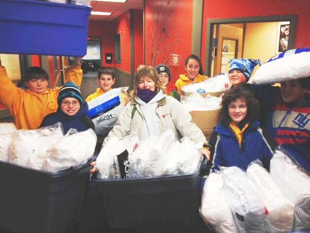 St. Mary?s Academy teacher Donna Cuddihy and her sixth-graders at the Hoosick Falls school provided pillows and pillow cases for every guest staying at Interfaith Partnership for the Homeless in Albany as part of their community project focusing on homelessness. They also brought spices for the more than 40,000 meals made during the year, and combination locks for guests to keep their personal items safe.. Provide a meal or hold a donation drive that can help with much needed items for the guests at Interfaith Partnership for the Homeless.  Contact Adriana Battle for more information:  adrianab@interfaithpartnership.com or 434-8021 ext 108.  (Donna Cuddihy)