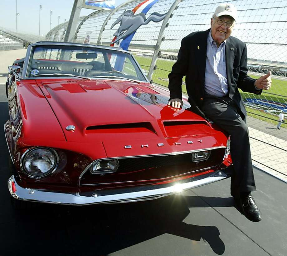 This April 15, 2004 file photo shows Carroll Shelby sitting on a 1968 GT500 KR during the celebration of the 40th Anniversary of the Ford Mustang at the Nashville Super Speedway in Lebanon, Tennessee.   Shelby, the greatest single influence on America's racing posture in the post-1945 period with help in the engine design and racing operations of the Mustang,  died May 10, 2012 at the age of 89. Photo: Jeff Haynes, AFP/Getty Images