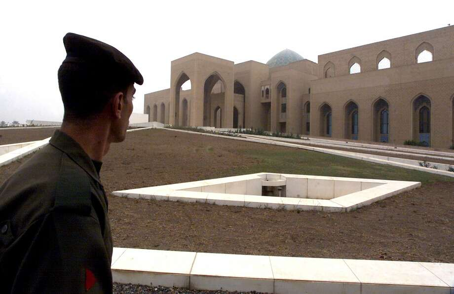 An Iraqi soldier stands guard outside the al-Sojoud presidential palace, one of Iraqi President Saddam Hussein's palaces in Iraq during his rule. Photo: Getty Images