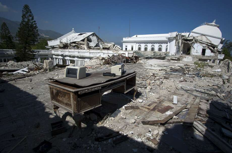 The Presidential Palace ended up in ruins after the 2010 Haiti Earthquake. The remains of the Beaux Arts structure were dismantled to build a successor.  Some of the surviving pieces of the palace were carried away by hand by local preservationists. Photo: Dieu Nalio Chery, AP