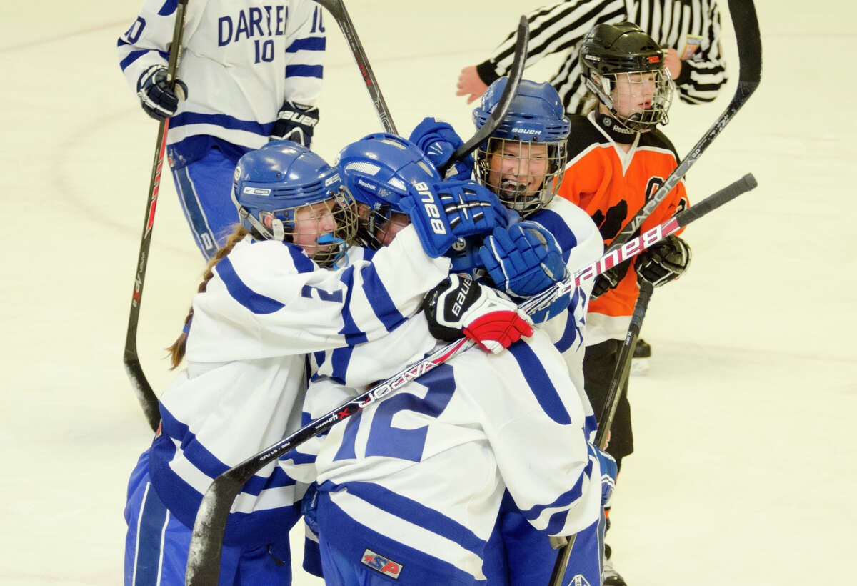 Darien's celebrates a goal during the FCIAC championship girls ice hockey game against Ridgefield High School at Terry Conners Rink in Stamford on Saturday, Mar. 2, 2014