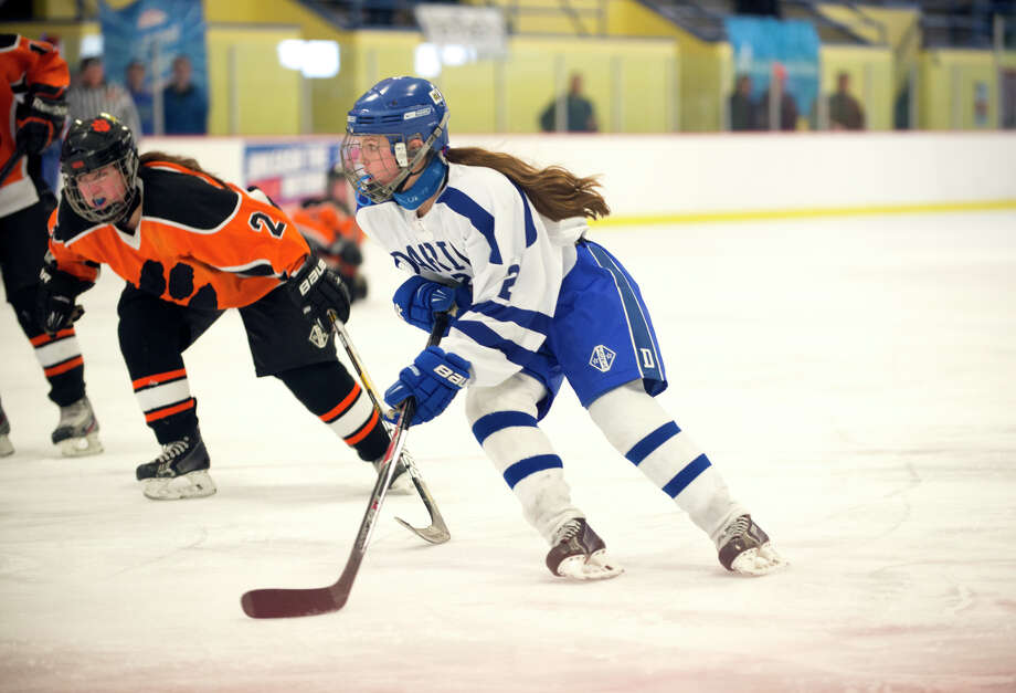 Darien's Georgia Cassidy (2) controls the puck during the FCIAC championship girls ice hockey game against Ridgefield High School at Terry Conners Rink in Stamford on Saturday, Mar. 2, 2014 Photo: Amy Mortensen / Connecticut Post Freelance