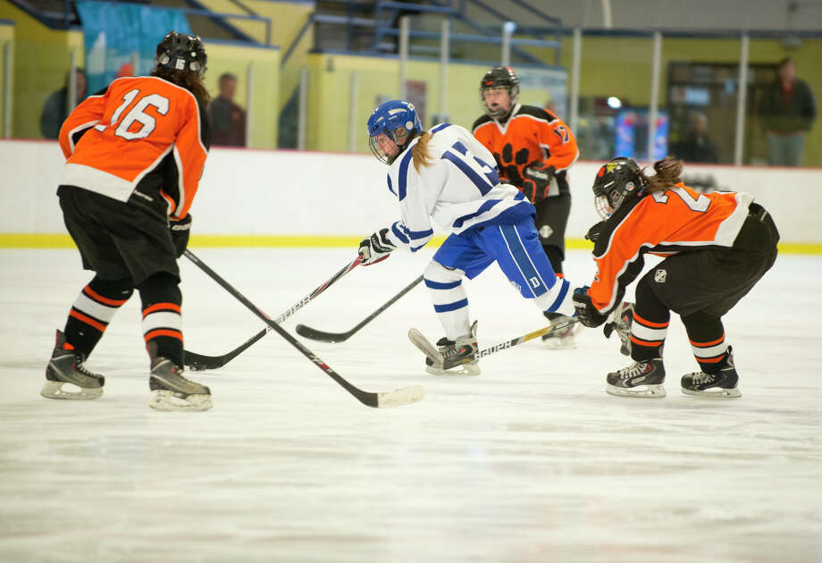Darien's Sage Thacher (13) controls the puck during the FCIAC championship girls ice hockey game against Ridgefield High School at Terry Conners Rink in Stamford on Saturday, Mar. 1, 2014 Photo: Amy Mortensen / Connecticut Post Freelance