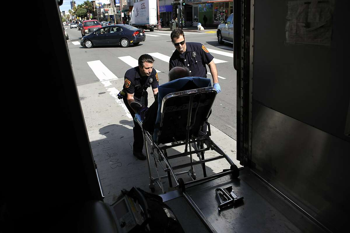 EMT Alex Lamond, right, and Paramedic Josh Smith wheel a diabetic patient, who called for help because he was feeling weak and dizzy, into their waiting ambulance, in San Francisco, CA Saturday, March 1, 2014.