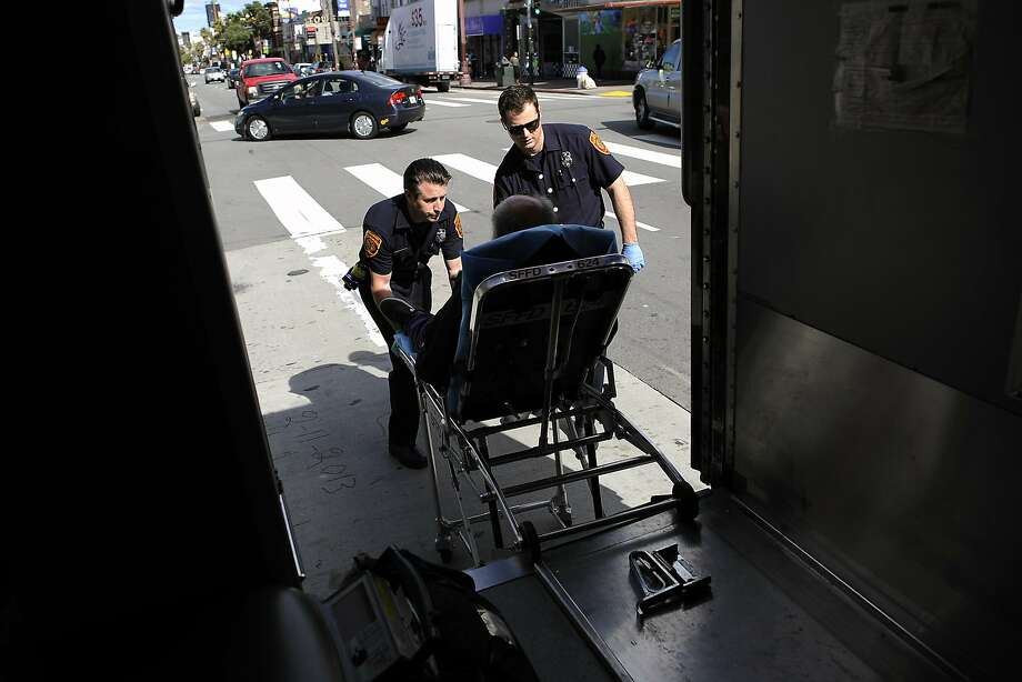 EMT Alex Lamond, right, and Paramedic Josh Smith wheel a diabetic patient, who called for help because he was feeling weak and dizzy, into their waiting ambulance, in San Francisco, CA Saturday, March 1, 2014. Photo: Michael Short, Special To The Chronicle
