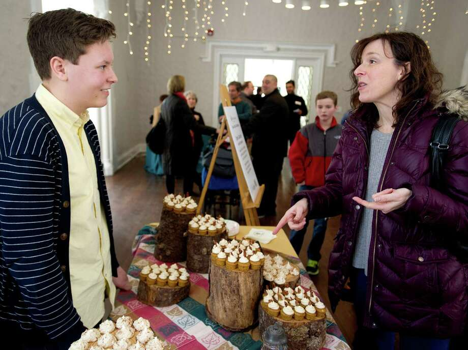 Alison Sherman talks to Evan Cassidy of North Branford about his sweet potato cupcakes with maple buttercream and candied bacon and maple meringues with cinnamon and toasted almonds  during the teen cooking competition as part of the Maple Sugar Festival at the Stamford Museum and Nature Center on Saturday, March 1, 2014. Photo: Lindsay Perry / Stamford Advocate