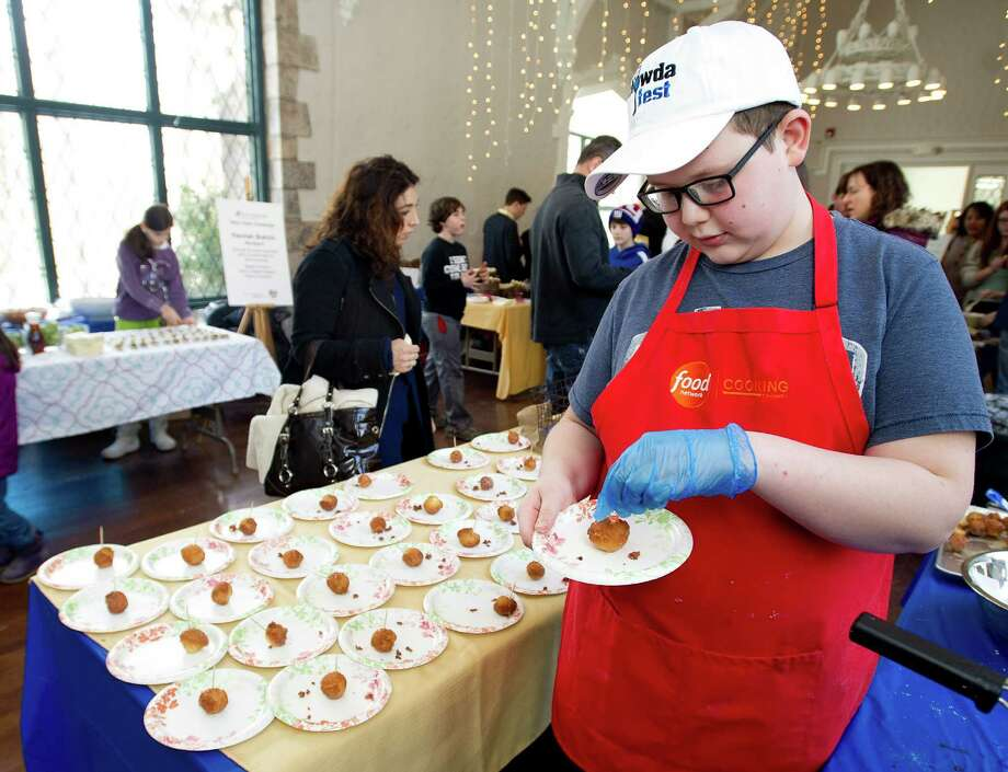 Hunter Zampa of Stamford makes more of his maple syrup donut delights during the teen cooking competition as part of the Maple Sugar Festival at the Stamford Museum and Nature Center on Saturday, March 1, 2014. Photo: Lindsay Perry / Stamford Advocate