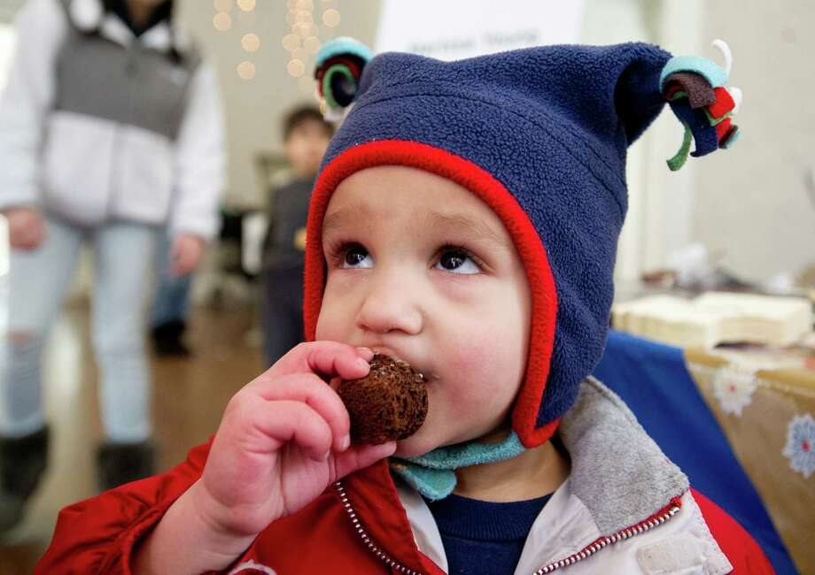 Etai Avidan, 1, tries devil's chocolate cupcakes with maple buttercream frosting made by Marissa Young of Stamford during the teen cooking competition as part of the Maple Sugar Festival at the Stamford Museum and Nature Center on Saturday, March 1, 2014. Photo: Lindsay Perry / Stamford Advocate