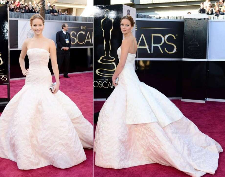 Jennifer Lawrence wore a gorgeous Dior gown to the 2013 Oscars. Photo taken by Jason Merritt, Frederic J. Brown/Getty Images.