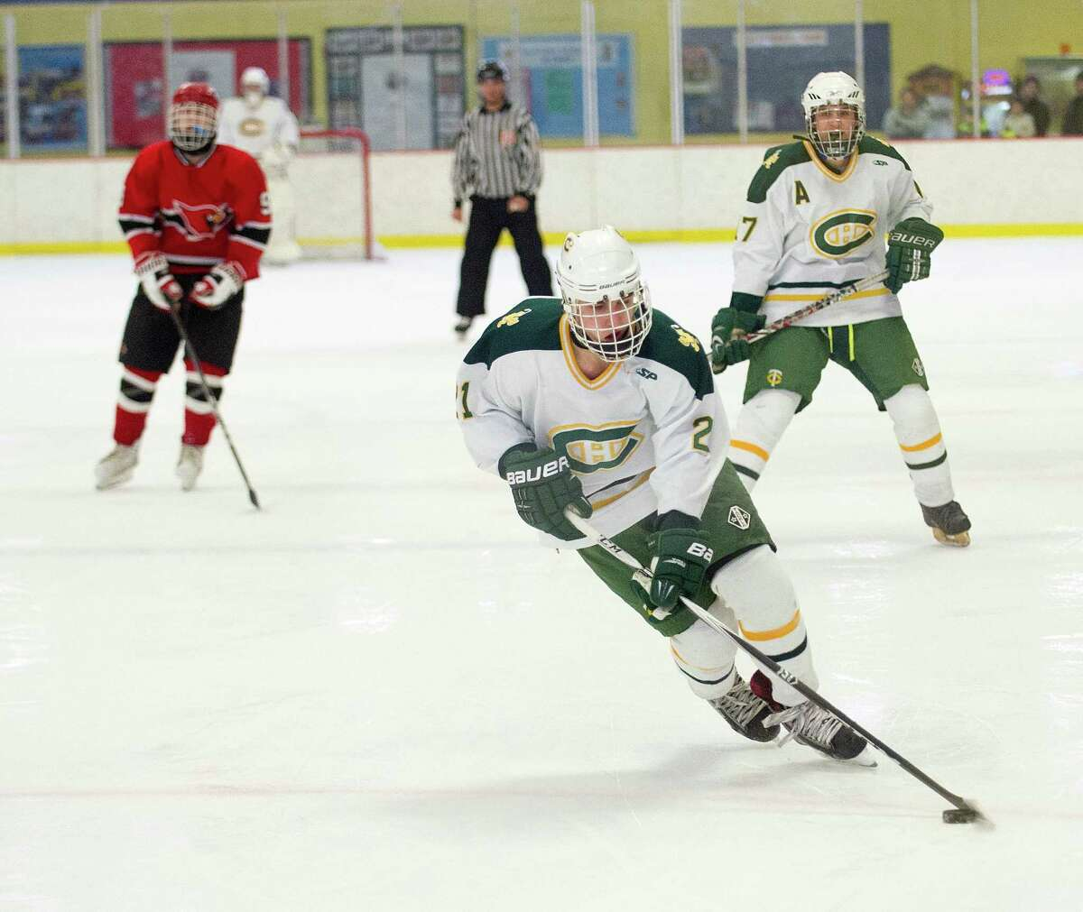 Trinity Catholic's Carmine DeRubeis controls the puck during Saturday's FCIAC quarterfinal against Greenwich at Terry Conners Rink in Stamford, Conn., on March 1, 2014.