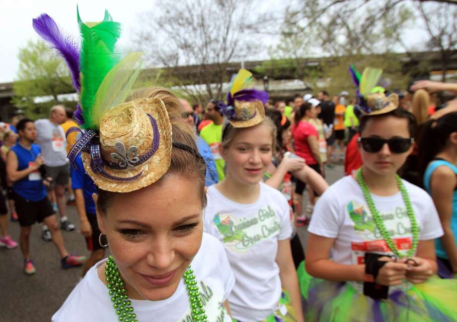 Jenifer Moss wears a costume for the Conoco Phillips Rodeo Run on Saturday, March 1, 2014, in Houston. ( Mayra Beltran / Houston Chronicle ) Photo: Houston Chronicle