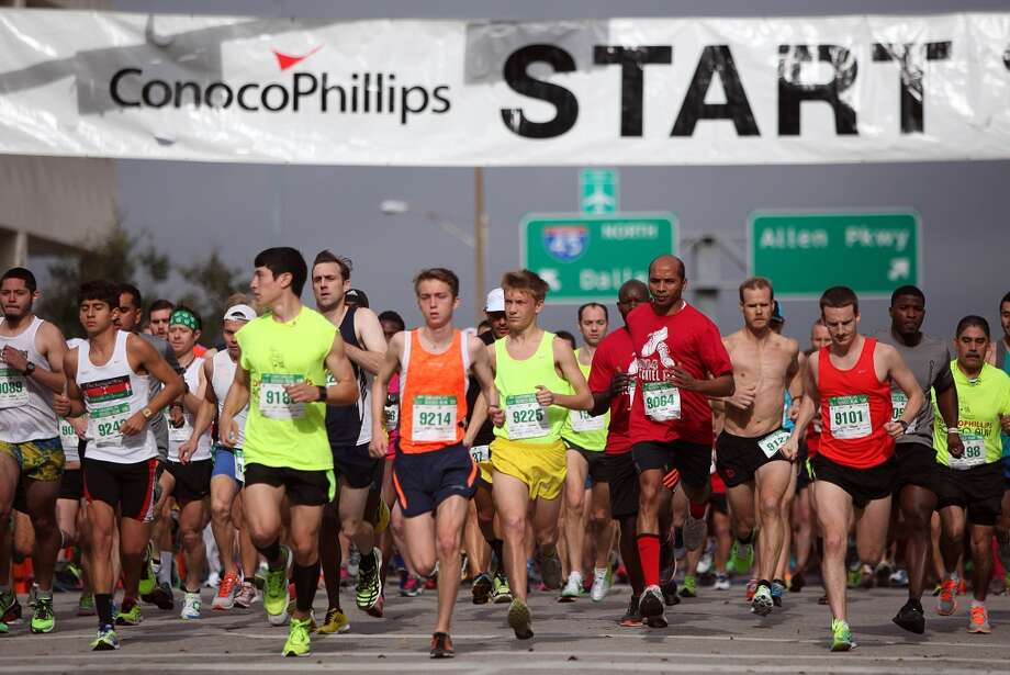 Runs take off at the starting line of the Conoco Phillips Rodeo 10K Race on Saturday, March 1, 2014, in Houston. ( Mayra Beltran / Houston Chronicle ) Photo: Houston Chronicle