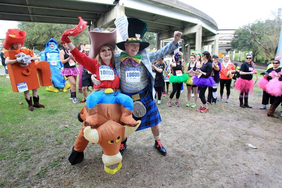 Elise Nellsch, 22, and John Roberts win the Conoco Phillips Rodeo Run Costume Contest on Saturday, March 1, 2014, in Houston. ( Mayra Beltran / Houston Chronicle ) Photo: Houston Chronicle