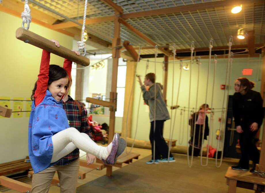 Magdalena Subotkowski, 4, of Guilford, rides the zip line Saturday, Mar. 1, 2014, in the Adventure Science exhibit at the Discovery Museum and Planetarium in Bridgeport, Conn. The visiting exhibit, inspired by The Adventure Park, a popular five-acre aerial forest park that opened last summer behind the Museum, will run through Sunday, Mar. 9, 2014. Photo: Autumn Driscoll / Connecticut Post