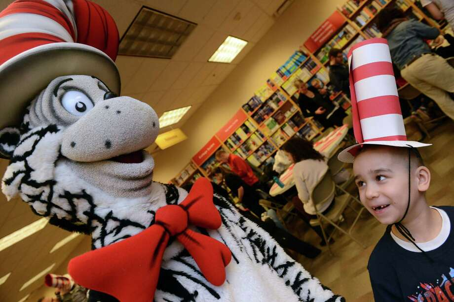 Alvin Coreano, 6, of Bridgeport, wears his hat craft as he meets the Cat In The Hat during a story time event to celebrate Read Across America Saturday, Mar. 1, 2014, at the Fairfield University Bookstore in downtown Fairfield, Conn. Photo: Autumn Driscoll / Connecticut Post