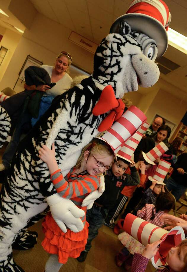 Lillian Schilling, 6, of Fairfield, gives the Cat In The Hat a big hug during a story time event to celebrate Read Across America Saturday, Mar. 1, 2014, at the Fairfield University Bookstore in downtown Fairfield, Conn. Photo: Autumn Driscoll / Connecticut Post