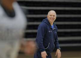 Head Coach Randy Bennett watches his players during St. Mary's College men's basketball practice at McKeon Pavilion in Moraga, Calif., on Monday, October 28, 2013.