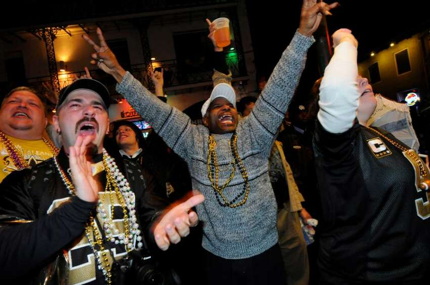 NEW ORLEANS - FEBRUARY 07: Fans celebrate the New Orleans Saints win against the Indianapolis Colts during Super Bowl XLIV on Bourbon Street in the French Quarter on February 7, 2010 in New Orleans, Louisiana. The Saints defeated the Colts, 31-17. (Photo by Cheryl Gerber/Getty Images)