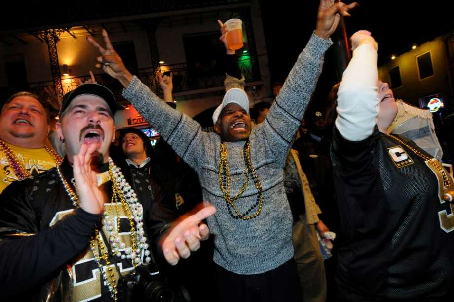 NEW ORLEANS - FEBRUARY 07:  Fans celebrate the New Orleans Saints win against the Indianapolis Colts during Super Bowl XLIV on Bourbon Street in the French Quarter on February 7, 2010 in New Orleans, Louisiana.  The Saints defeated the Colts, 31-17.  (Photo by Cheryl Gerber/Getty Images) Photo: Cheryl Gerber, Getty Images / 2010 Getty Images