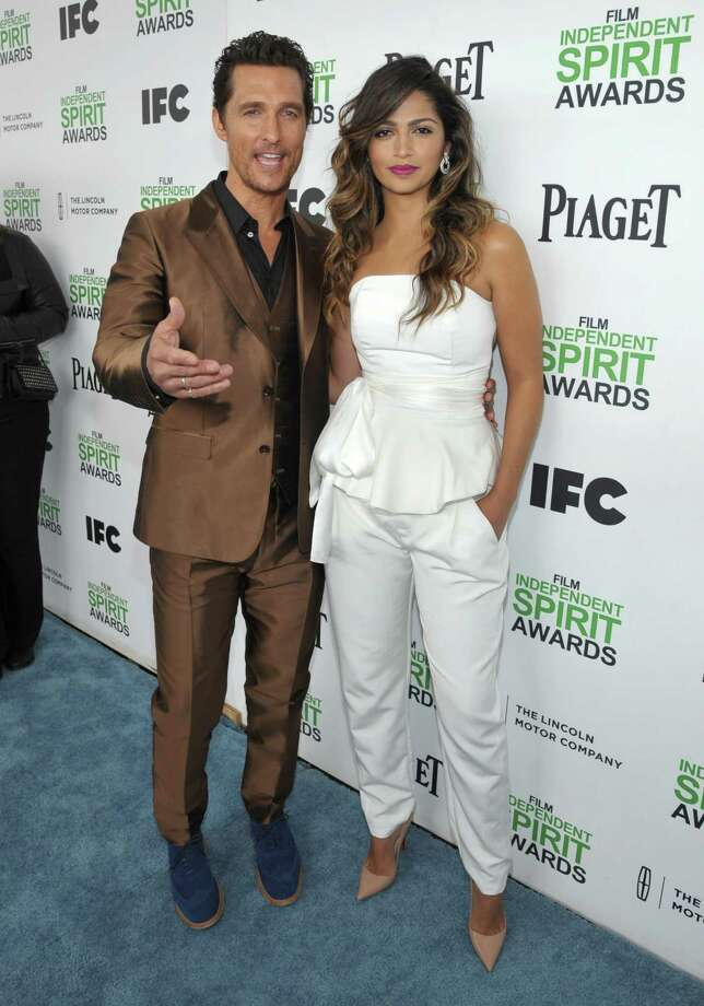 Matthew McConaughey, left, and Camila Alves arrive. Photo: John Shearer, John Shearer/Invision/AP / Invision