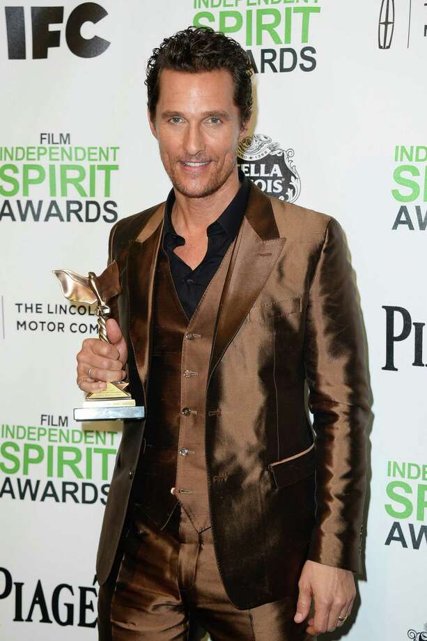 "Matthew McConaughey poses with the award for best male lead for ""Dallas Buyers Club"" in the press room. Photo: Jordan Strauss, Jordan Strauss/Invision/AP / Invision"