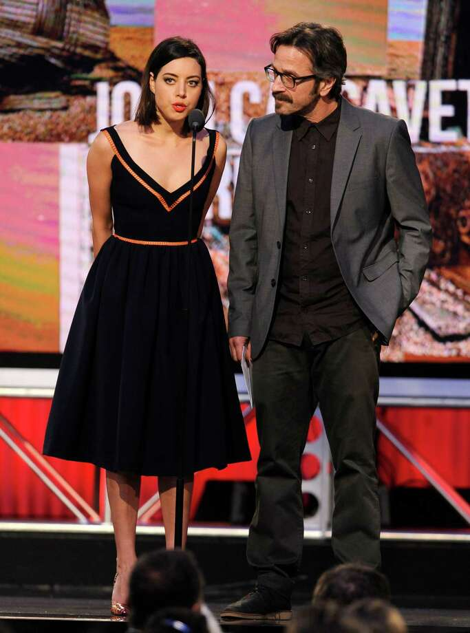 Aubrey Plaza, left, and Marc Maron speak on stage. Photo: Chris Pizzello, Chris Pizzello/Invision/AP / Invision