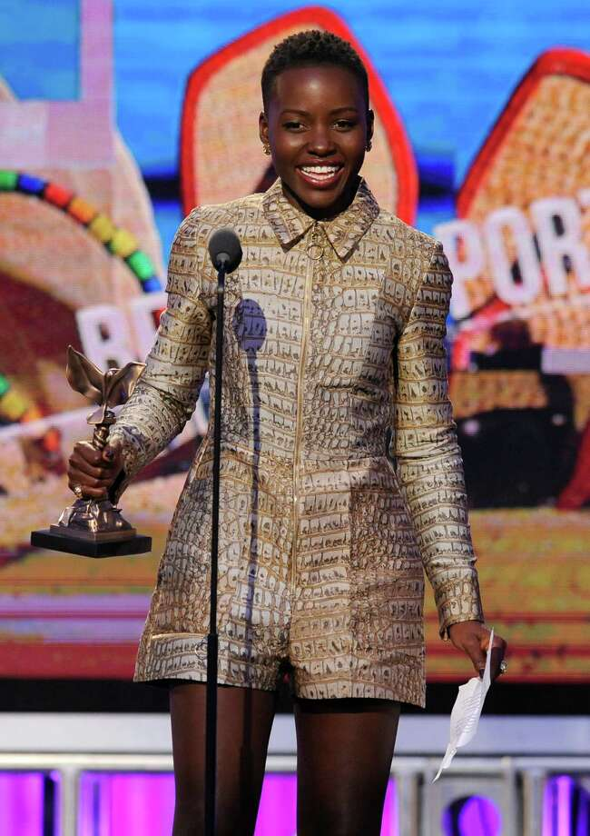Lupita Nyong'o accepts the award for best supporting female on stage. Photo: Chris Pizzello, Chris Pizzello/Invision/AP / Invision