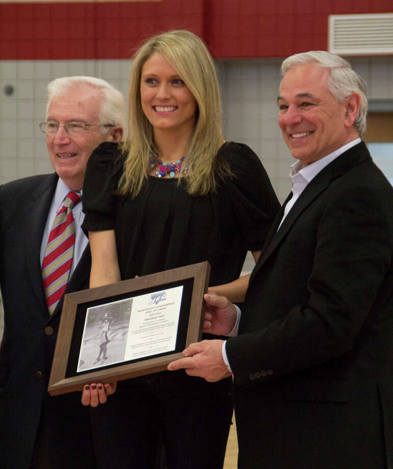 Stamford natibe and former Sacred Heart University star Amanda Pape stands with retired atheltic director Don Cook an d current AD Bobby Valentine during a ceremony Saturday at the Pitt Center. The Pinoneers honored Paper for her induction into the NEC Hall of Fame. Photo: Contributed Photo, Sean Elliott/Sacred Heart Univer / Stamford Advocate Contributed