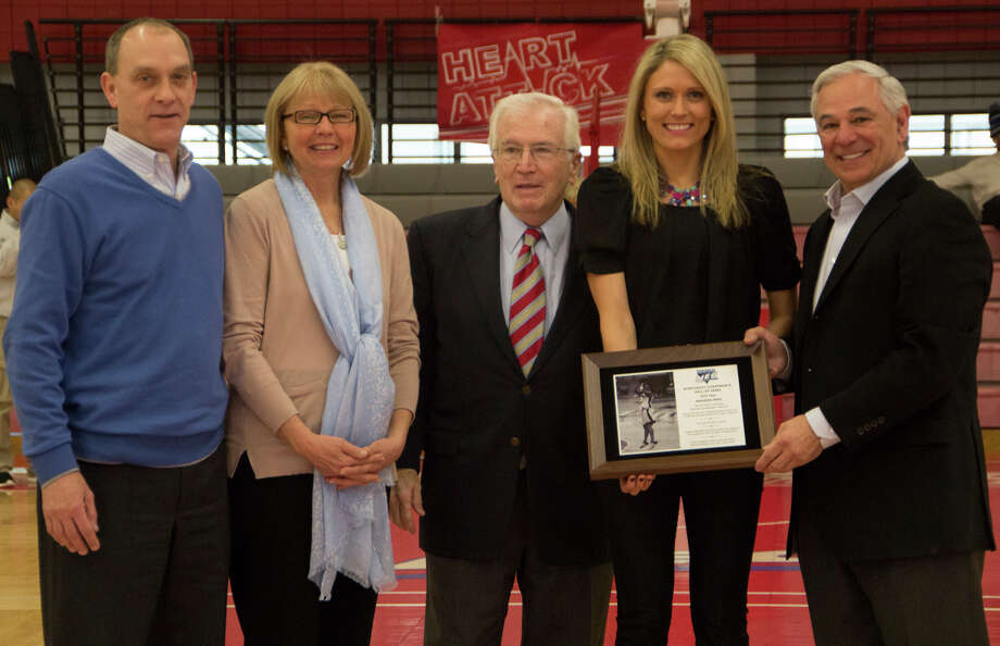 From left to right: Richard Pape, Linda Pape, Don Cook, Amanda Pape and Bobby Valentine stand a center court at the Pitt Center. Pape, a Stamford native and former Sacred Heart star was honored for her induction to the NEC Hall of Fame. Photo: Contributed Photo, Sean Elliott/Sacred Heart Univer / Stamford Advocate Contributed