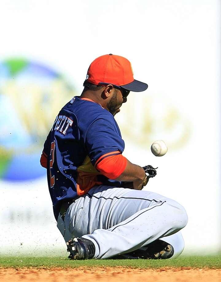 Gregorio Petit tries to catch a ball hit by Detroit's Francisco Martinez. Photo: Karen Warren, Houston Chronicle