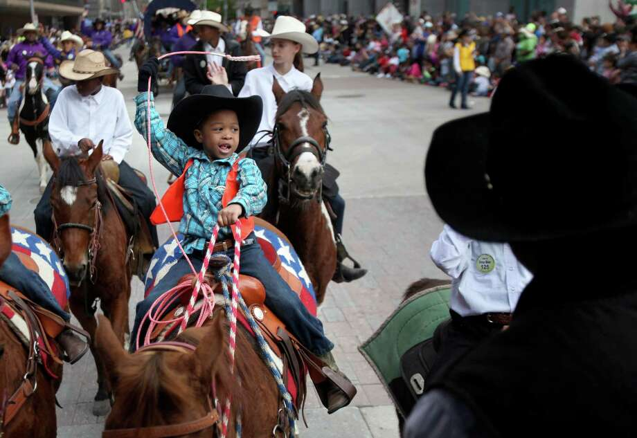 Chance Horace waves at the crowd while riding with 7W-Uke Prairie View Trail Riders during the 76th Annual Houston Rodeo Parade celebrating western heritage as is kicks-off the Houston Livestock Show and Rodeo season on Saturday, March 1, 2014, in Houston. Photo: Mayra Beltran, Houston Chronicle / © 2014 Houston Chronicle