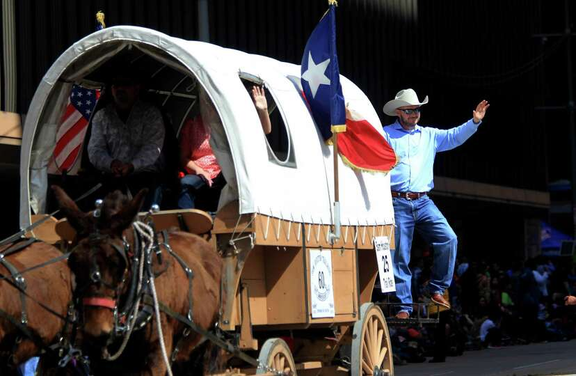 Collin McShan with the Sam Houston Trail ride waves to the crowds during the 76th Annual Houston Rod