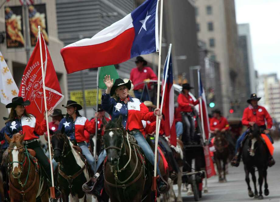 Texas Independence Trail Riders participate in the 76th Annual Houston Rodeo Parade. Photo: Mayra Beltran, Houston Chronicle / © 2014 Houston Chronicle