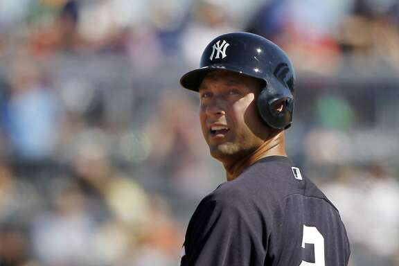 Mar 1, 2014; Tampa, FL, USA; New York Yankees shortstop Derek Jeter (2) looks back while on base during the fifth inning against the Philadelphia Phillies at George M. Steinbrenner Field. Mandatory Credit: Kim Klement-USA TODAY Sports