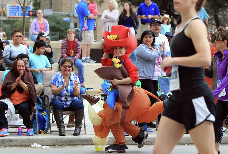 Elise Nellsch, 22, wears a costume for the 5K Conoco Phillips Rodeo Run on Saturday, March 1, 2014,