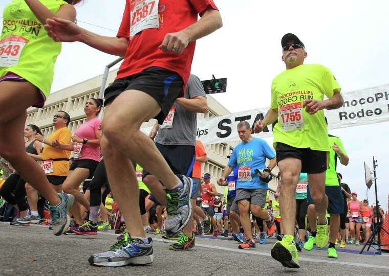 Runners kick off the Conoco Phillips Rodeo Run, 10K Race, on Saturday, March 1, 2014, in Houston.