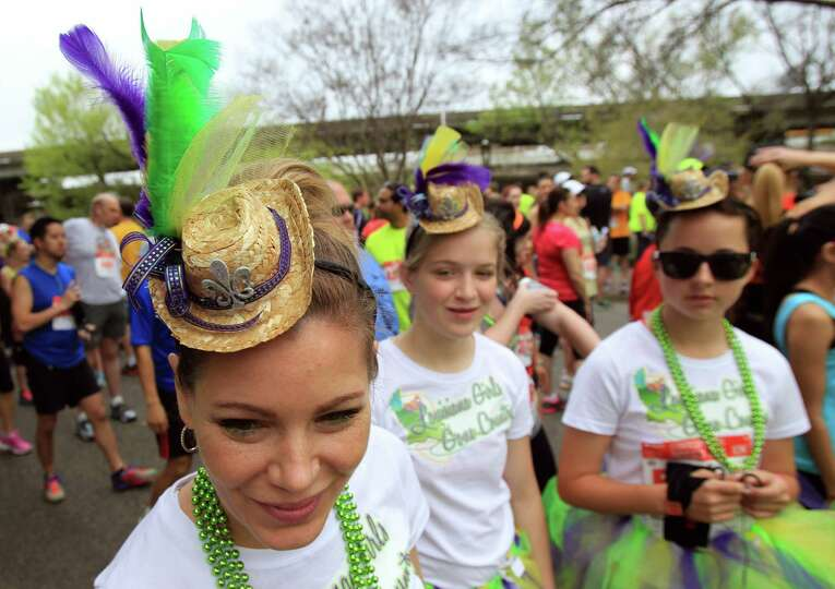 Jenifer Moss wears a costume for the Conoco Phillips Rodeo Run on Saturday, March 1, 2014, in Housto