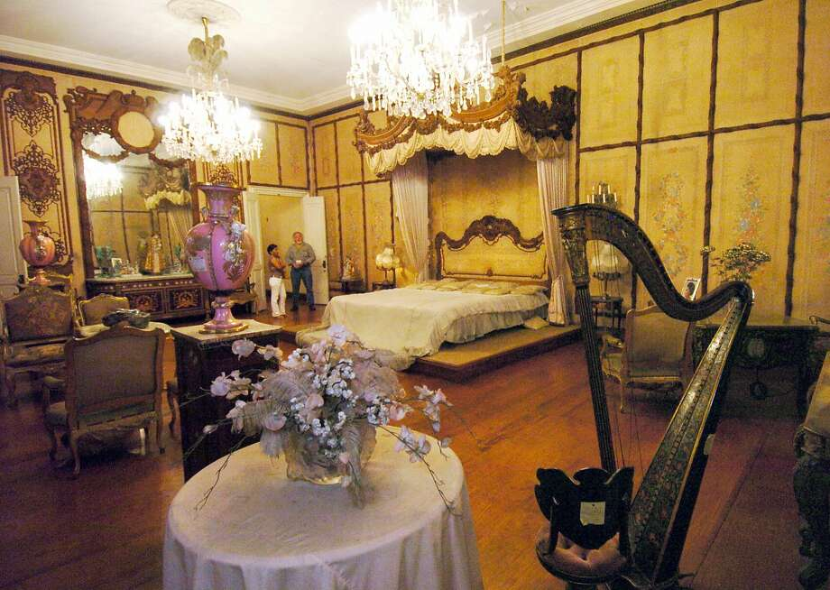 Visitors view the bedroom of Imelda Marcos at the Santo Nino shrine in 2004 that was sequestered by the government. When the former first lady built the mansion in 1981 in her hometown Tacloban, it was dubbed by many as the Malacanang presidential palace of the south. The mansion named after religious icon of the Child Jesus stands as a monument to the obscene excesses of the Marcos years when the late dictator Ferdinand Marcos was deposed by a military-backed people power revolt in 1986 after 20 years in power. Photo: Romeo Gacad