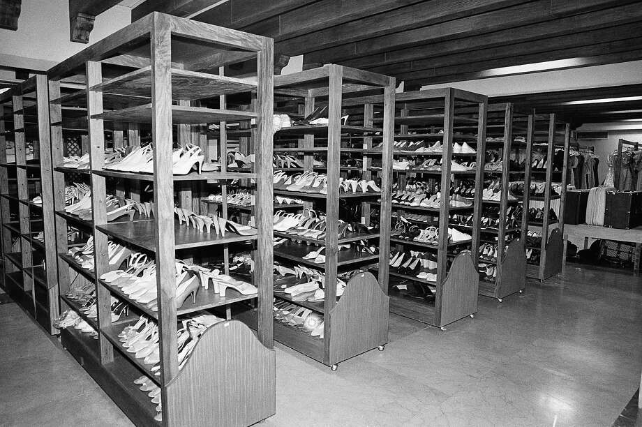 An estimated 3,000 pairs of shoes belonging to Imelda R. Marcos line up the shelves in the basement of the presidential palace in Manila, which also held hundreds of clothes belonging to the former Philippine first lady.  Photo: Alberto Marquez, AP