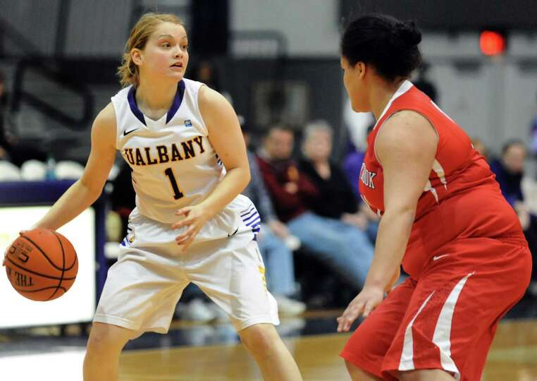UAlbany's Erin Coughlin, left, looks to pass as Stony Brook's Kori Bayne-Walker defends during their