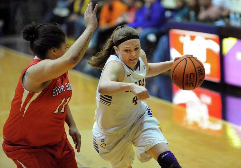 UAlbany's Sarah Royals, right, drives past Stony Brook's Kori Bayne-Walker during their basketball g