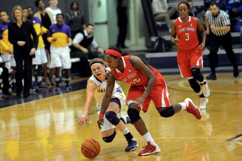 UAlbany's Sarah Royals, center, and Stony Brook's Chikilra Goodman chase down a loose ball during th