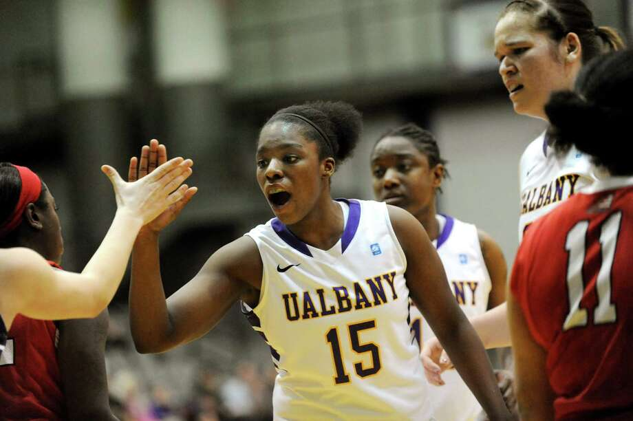 UAlbany's Jessica Fequiere, center, cheers on teammate Sarah Royals (not pictured) when she draws a foul during their basketball game against Stony Brook on Saturday, March 1, 2014, at UAlbany in Albany, N.Y. (Cindy Schultz / Times Union) Photo: Cindy Schultz / 00025922A