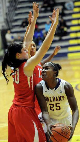 UAlbany's Shereesha Richards, right, looks to the hoop as Stony Brook's Brittany Snow defends during