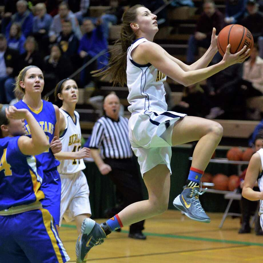 Averill Park's # 5 Kelly Donnelly, right, drives to the net during the Class A girls' final against Queensbury Saturday March 1, 2014, in Troy.   (John Carl D'Annibale / Times Union) Photo: John Carl D'Annibale / 00025936A