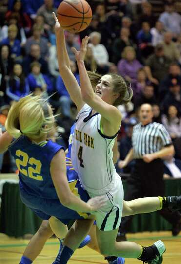 Queensbury's #22 Jill Davis, left, and Averill Park's # 4 Jenna Miner collide during the Class A gir