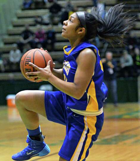 Queensbury's #20 Nikari Carota begins a lay up  's # 15 during the Class A girls' final against Aver