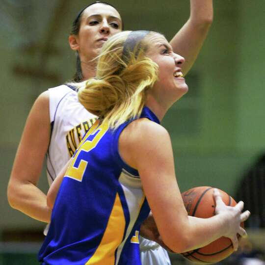Queensbury's #22 Jill Davis drives past Averill Park's #15 Lauren Vanroy, left, during the Class A g