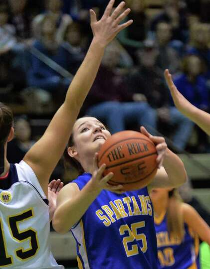 Queensbury's #25 Kelly McLaughlin tries to get a shot off against Averill Park during the Class A gi