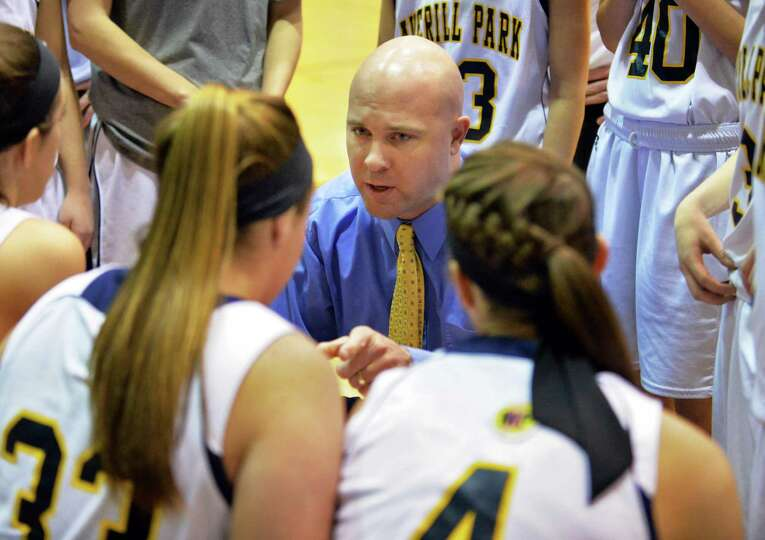 Averill Park head coach Sean Organ with his team during the Class A girls' final against Queensbury